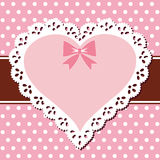 Lace pink heart. Oval vintage lace frame on a polka dot blue background Stock Photography