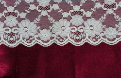 Lace and red satin Stock Photos