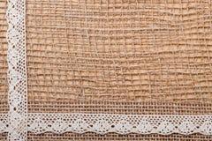 Lace ribbon on burlap cloth background Royalty Free Stock Photo