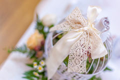 Lace ribbon decoration. Event decoration with lace ribbon, roses and miniature bird cage Stock Photography
