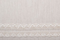Lace ribbon on linen cloth background Stock Photo