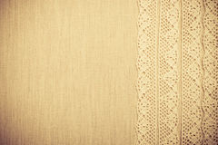 Lace ribbon on linen cloth background Royalty Free Stock Images