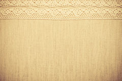 Lace ribbon on linen cloth background Royalty Free Stock Photography