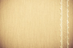 Lace ribbon on linen cloth background Stock Image