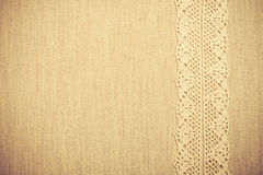 Lace ribbon on linen cloth background Royalty Free Stock Photo