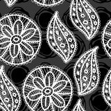 Lace seamless pattern with flowers and leaves on black background. Royalty Free Stock Images