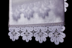 Lace in shadow on towel Stock Image