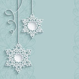 Lace snowflake pendants on neutral background Stock Images