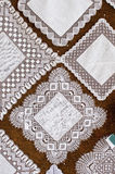 Lace squares, Spain. Intricate lace square with nuestra Boda embroidered in the centre.  Camariñas, Galicia, Spain Stock Photos