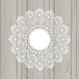Lace style mandala on a wooden background royalty free illustration