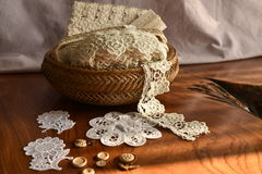 Lace tape in a wicker basket on the table. Fringe or lace tapes in a wicker basket stock photos
