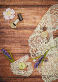 Lace and thread on wooden background Royalty Free Stock Photography