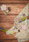 Lace and thread on wooden background Stock Photography