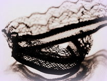 Lace time. Laced ribbon in black color with bright background Royalty Free Stock Photo