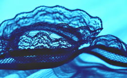Lace. Laced ribbon in a blue, ocean tones Stock Image