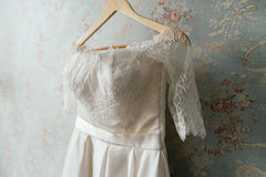 Lace top wedd dress hanging on the wall. Lace top wedding dress hanging on the wall Stock Images