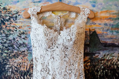Lace top wedd dress hanging on the wall. Lace top wedding dress hanging on the wall Stock Photography