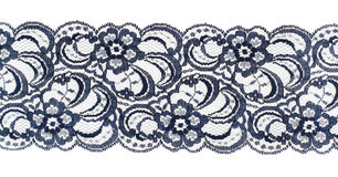 Lace trim ribbon over white. Fabric. Closeup Royalty Free Stock Photo