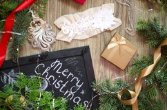 Lace underwear with the red and golden gift boxes on the Christmas festive background. Merry Christmas and a Happy New Year celeb stock photo