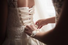 Lace-up wedding dress. White dress of the bride. royalty free stock photo