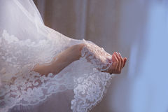 Lace veil in the hand. Of the bride Royalty Free Stock Photography