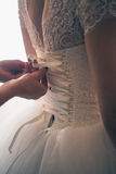 Lace wedding dress back of a young bride Royalty Free Stock Photography