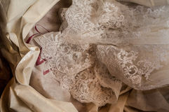 Lace wedding dress. Detail of a  white wedding dress made of lace Royalty Free Stock Images