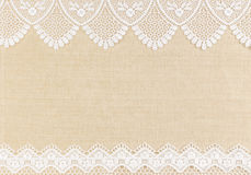 Lace. White Ornamental Lace over fabric design for border or background Royalty Free Stock Image