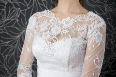 Lace white wedding dress closeup. Beadwork macro Stock Photos