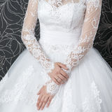 Lace white wedding dress with long sleeves Royalty Free Stock Photo