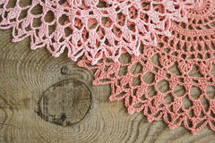 Lace on wood. Handmade openwork napkins on weathered wood Stock Images
