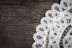Lace on the wooden background Royalty Free Stock Photography