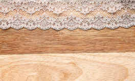 Lace on wooden background Stock Photos