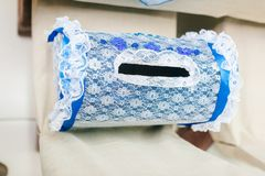 Laced blue piggy bank for newlyweds on a white background stock image