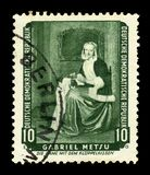 Lacemaker by Gabriel Metsu. German Democratic Republic East Germany - circa 1959: A stamp printed in German Democratic Republic shows `The Needlewoman` Lacemaker royalty free stock photography
