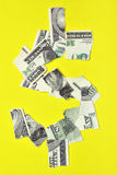 Lacerated dollar. Lacerated banknote looking as dollar sign Stock Images