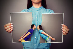 Lacerated photo of young kissing couple Royalty Free Stock Images