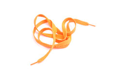 Laces. Orange shoe laces isolated on white royalty free stock photography
