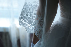 Laces on back of wedding dress Stock Photos