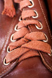 Laces of brown shoes Stock Photos