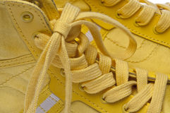 Laces of Yellow Shoes Royalty Free Stock Images