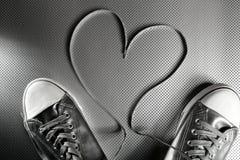 Lacets des chaussures argentées Photo stock