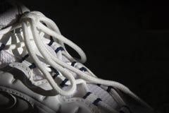 Lacets sur les chaussures de course Photo stock