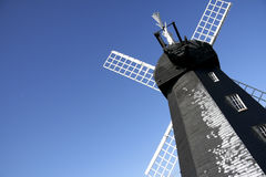 Lacey green windmill blue summer sky Stock Photo