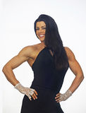 Lacey, Luscious and Buff. Luscious fitness model and professional figure competitor, Jill Soscia, strikes an alluring hands-on-hips pose featuring her chiseled royalty free stock image