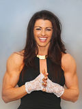 Lacey, Luscious and Buff. Luscious fitness model and professional figure competitor, Jill Soscia, strikes an alluring pose featuring her chiseled arms and stock images