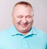Lachen des älteren Mannes Stockfotos