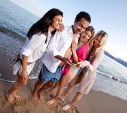Lachen-Mobiltelefon Stockfoto