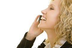 Lachen am Telefon Stockbild