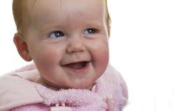 Lachend babymeisje in roze Royalty-vrije Stock Afbeeldingen
